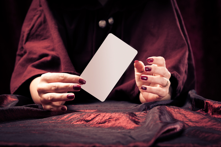 fortune teller with with blank tarot card - easily add your own message or design.