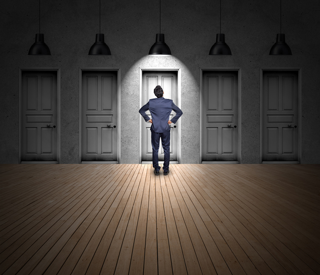 Businessman standing - door choice.