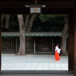 Tokyo, Japan - August 28, 2014: Maidens in traditional gowns at the Meiji Shrine, a Shinto complex in Tokyo dedicated to the Emperor Meiji and his wife, Empress Sh?ken. Completed in 1926, it is situated in 175 acres of forests in Yoyogi Park.